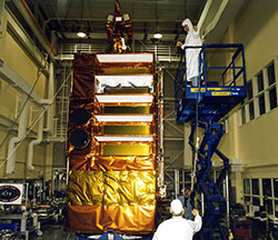 The Rossi X-ray Timing Explorer spacecraft undergoes pre-launch tests.