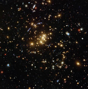 Image of the rich galaxy cluster catalogued as Cl 0024+17, allowing astronomers to probe the distribution of dark matter in space.